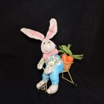 burton + Burton Plush Linen Easter Bunny On Bicycle With Blue Overalls