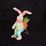 burton + Burton Plush Linen Easter Bunny On Bicycle With Green Overalls